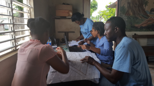 GIS Analyst and Land Technical Specialist working in the community with mapping and verification assistants to record in the GIS database information (sketches of houses and plots, building materials, owner and tenant names) gathered in the field.