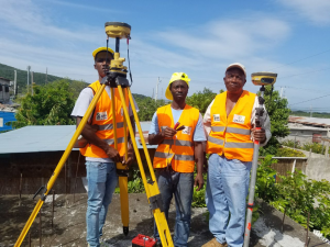 Junior land surveying technician and survey assistant, trained community members, assisting the licensed surveyor to set up GPS equipment.